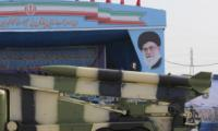 An Iranian military truck carries missiles past a portrait of Iran's Supreme Leader Ayatollah Ali Khamenei during a parade in Tehran on national army day on 18 April 2018. Atta Kenare/AFP/Getty Images